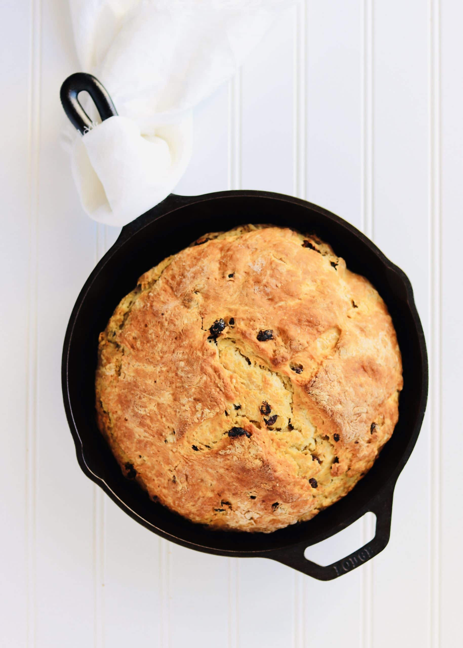 Irish Soda Bread is an easy quick bread. No yeast required! Buttermilk and baking soda help the bread rise. This recipe yields a bread that is dense, soft, and has a crispy, golden crust. Perfect to make for St. Patrick's Day or any day of the year!