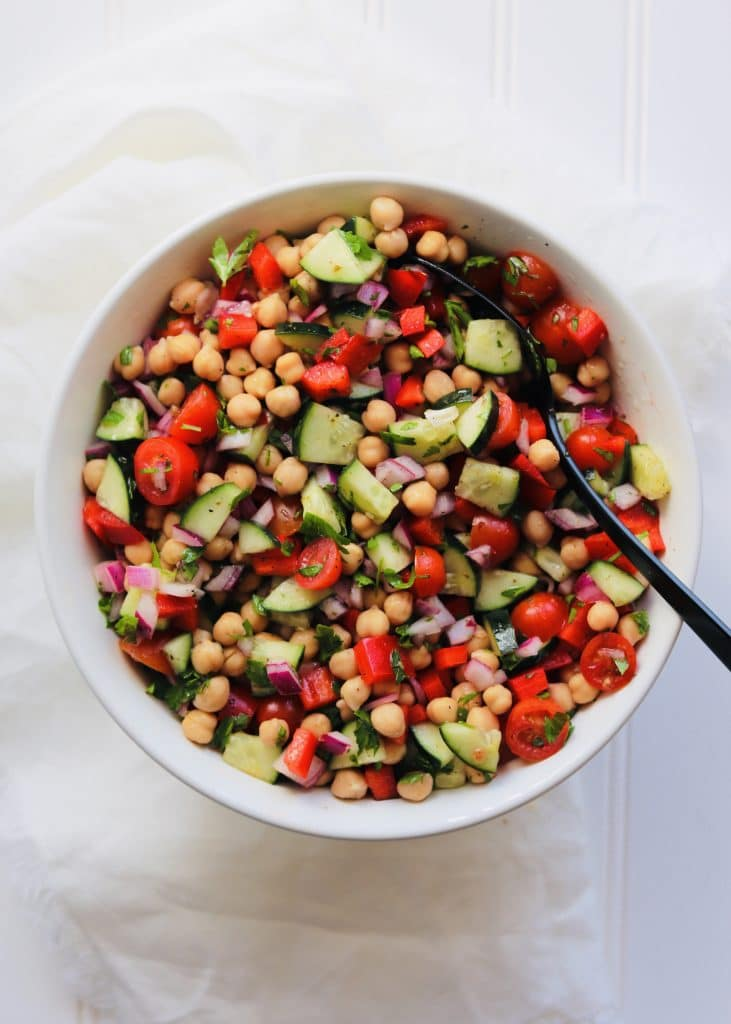 Greek Chickpea Salad in bowl with spoon