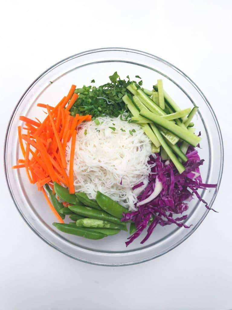 Refreshing noodle salad filled with yummy Asian flavors thanks to the easy sauce that we whip up in our blender or food processor. Filled with lots of veggie that add great color and crunch. This salad is best served cold so meet your new favorite way to elevate your weekday lunches.