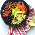 Crispy Chickpea Burrito Bowls are meal prep friendly and vegetarian (even vegan). Protein and fiber from the chickpeas, quinoa, AND black beans. These vegan burrito bowls are perfect for a weekday lunch or dinner. Recipe at Kathleenscravings.com #chickpeaburritobowls #chickpeaburritos #veganburritobowl #veganburritos #healthyburritobowls #veganmealprep #meatlessmealprep #healthymealprep