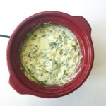Warm, cheesy, gooey Slow Cooker Spinach Artichoke Dip made in your crock-pot! An easy, crowd pleasing, appetizer perfect for your holiday party, game watch, or tailgate. Serve pita chips, tortilla chips, or sliced baguette with this creamy, hassle free slow cooker dip. Recipe at KathleensCravings.com
