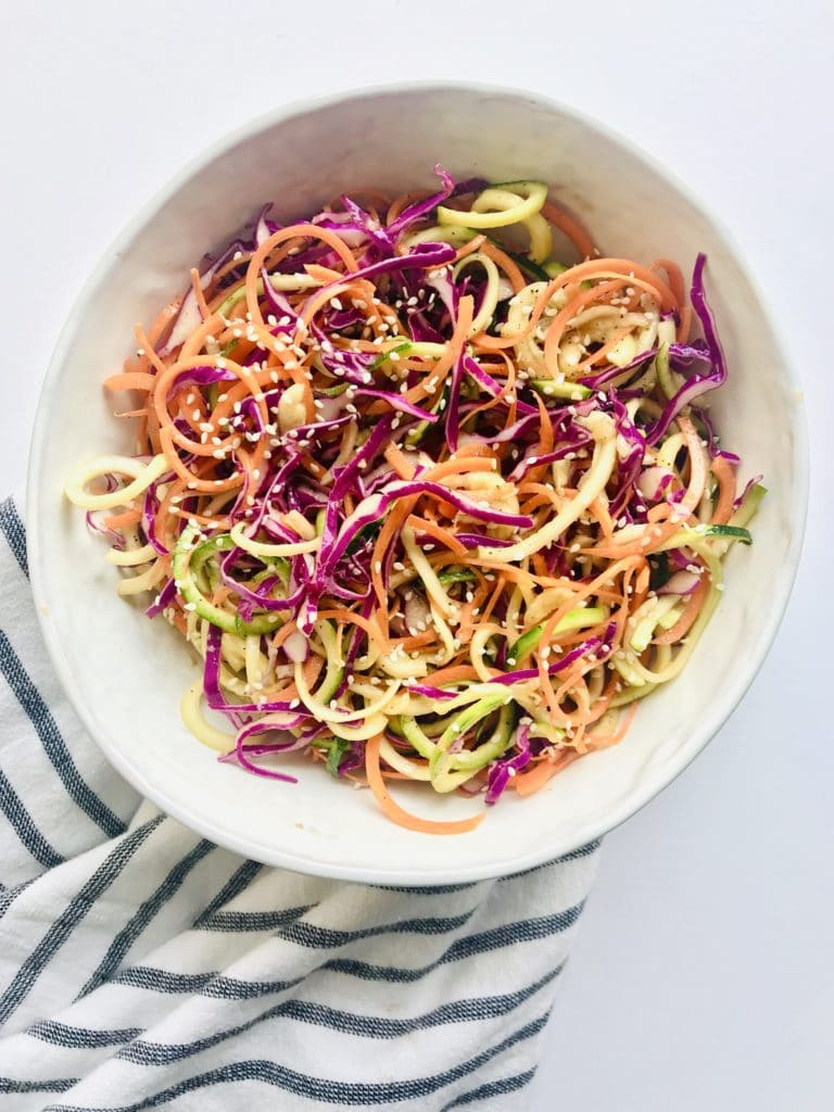 Light, colorful, and fresh. The Sesame Ginger Dressing adds an asian flair to this spiralized slaw salad. Recipe at KathleensCravings.com #spiralizedmeal #asianslaw #asiansalad #eatyourcolors