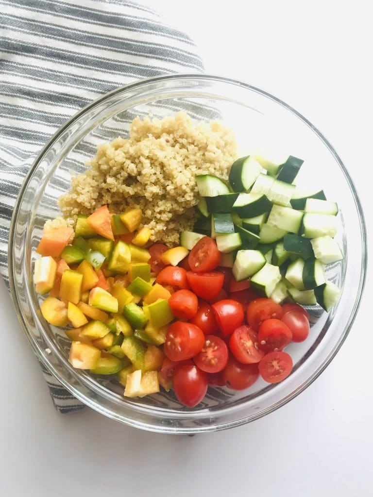 Rainbow Quinoa Salad is such an easy, fresh, colorful, and healthy recipe to have in your back pocket. Perfect for meal prep lunches, a summer potluck, or add a protein for an easy dinner. Quinoa packs a protein and fiber punch! An easy 3-ingredient dressing brings it all together! Recipe at Kathleenscravings.com #quinoasalad #vegansalad #veganmealprep