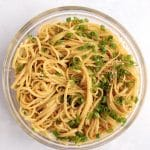 Bowl of easy sesame noodles with sliced green onions