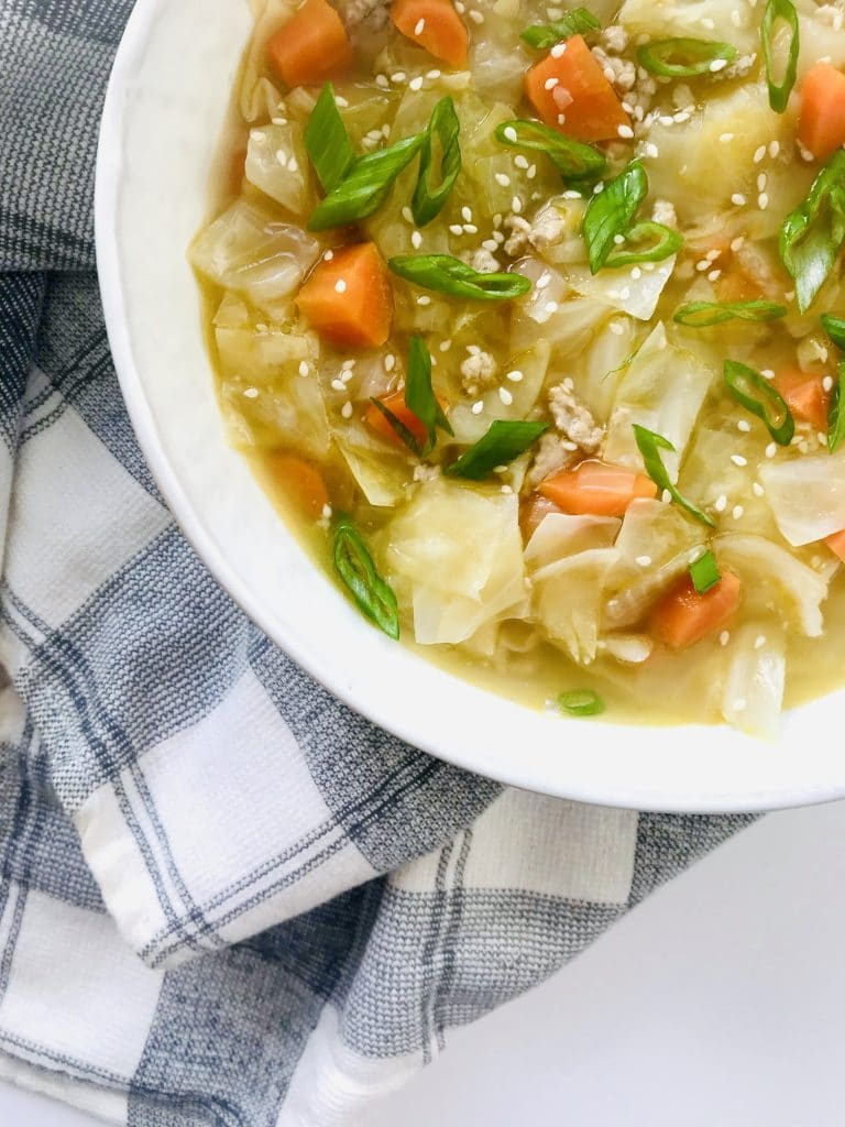 Pork Egg Roll Soup is comforting and healthy, but gives you the Asian flavors that you crave. Just 30 minutes start to finish. Super simple and easy. Recipe at KathleensCravings.com. #healthysoup #cabbagesoup #Asiansoup