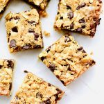 Gooey Chocolate Shortbread Bars start with the buttery, shortbread crust. And end with the topping that's filled with brown butter, oats, chocolate, and coconut. Melt in your mouth good. Recipe at KathleensCravings.com #kathleenscravings #shortbread #shortbreadbars #coconutdesserts #barrecipes #oatrecipes #brownbutter