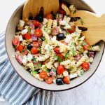 Italian Pasta Salad is the perfect easy dish to whip together for your next summer potluck. Customize the mix-ins to make your dream salad. Recipe at KathleensCravings.com #summerrecipe #potluckrecipe #pasta