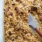 This Vanilla Maple Granola is simple to mix up, perfectly crunchy and sweet from the maple syrup and vanilla extract. Your breakfast game was just elevated. Recipe at KathleensCravings.com #homemadegranola