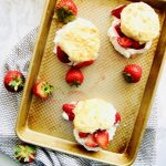 """data-pin-description=""""Classic Strawberry Shortcake requires a light and tender biscuit, sweet and sugary strawberries, all topped off with fluffy whipped cream. We elevate the traditional Strawberry Shortcake by adding Crème Fraîche to our homemade whipped creme. Recipe at Kathleenscravings.com #strawberrycake #strawberrydessert #strawberryshortcake #strawberryrecipes #cremefraiche"""""""