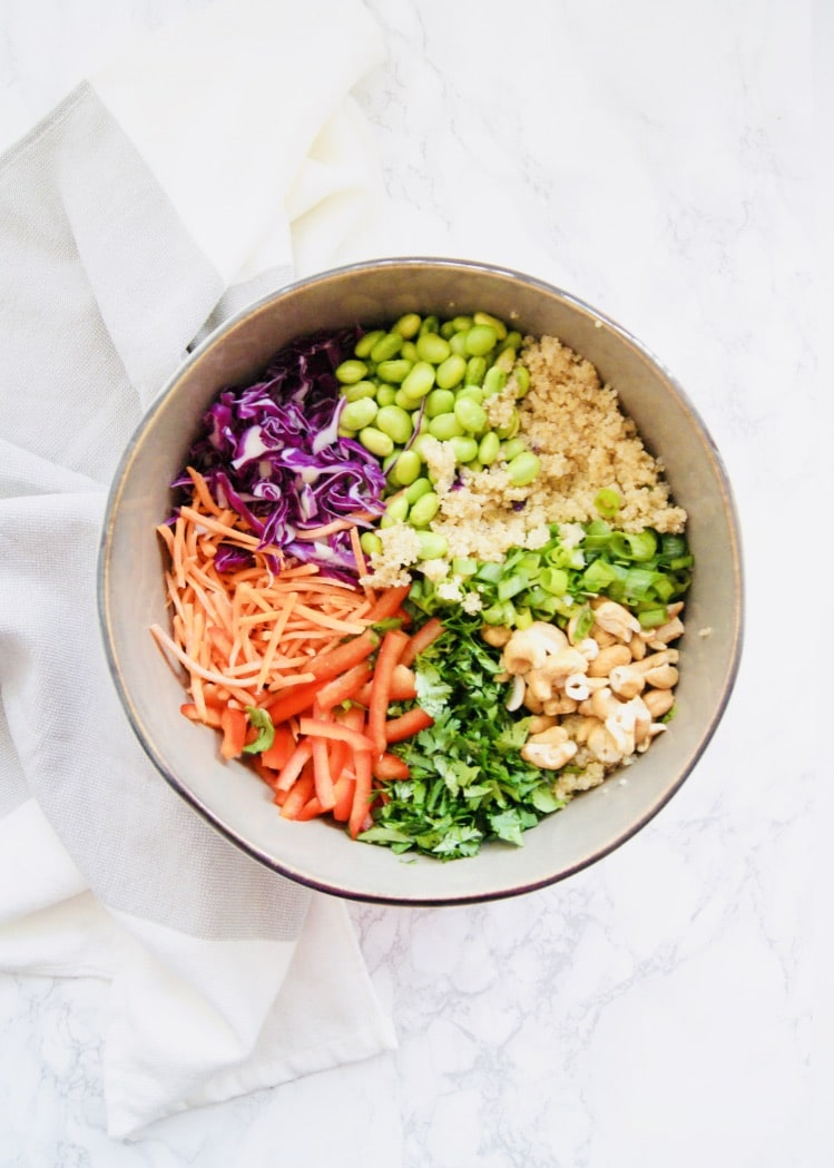 Ready in 30 minutes, this Vegan Thai Quinoa Salad is fresh, colorful, and filling. Packed with protein and perfect for meal prep. Tossed in an easy homemade sesame dressing. Serve as is or add a protein and serve as a side dish. Recipe at KathleensCravings.com #veganmealprep #veganquinoasalad #thaisalad #kathleenscravings #meatlessmealprep #plantbased #cleaneating