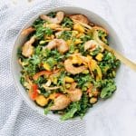 This Roasted Shrimp Thai Kale salad is light and refreshing, yet filling and big enough to serve a crowd. Lots of crunch and color and tossed with a homemade sesame dressing and topped with chili roasted shrimp. Recipe at KathleensCravings.com #thaisalad #kalesalad #shrimpsalad #saladdressingrecipe