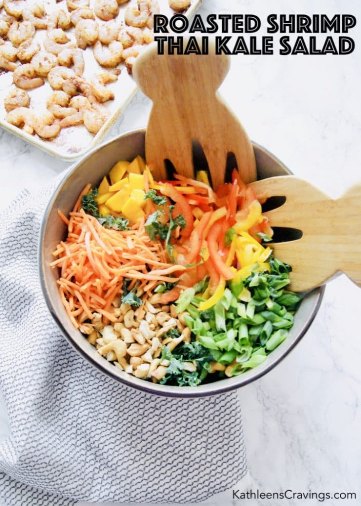 Thai salad ingredients in a large bowl with shrimp on sheet pan in background