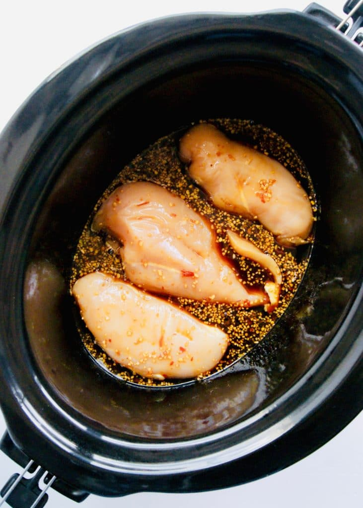 Close-up-of-chicken-breasts-in-honey-garlic-sauce-in-crockpot
