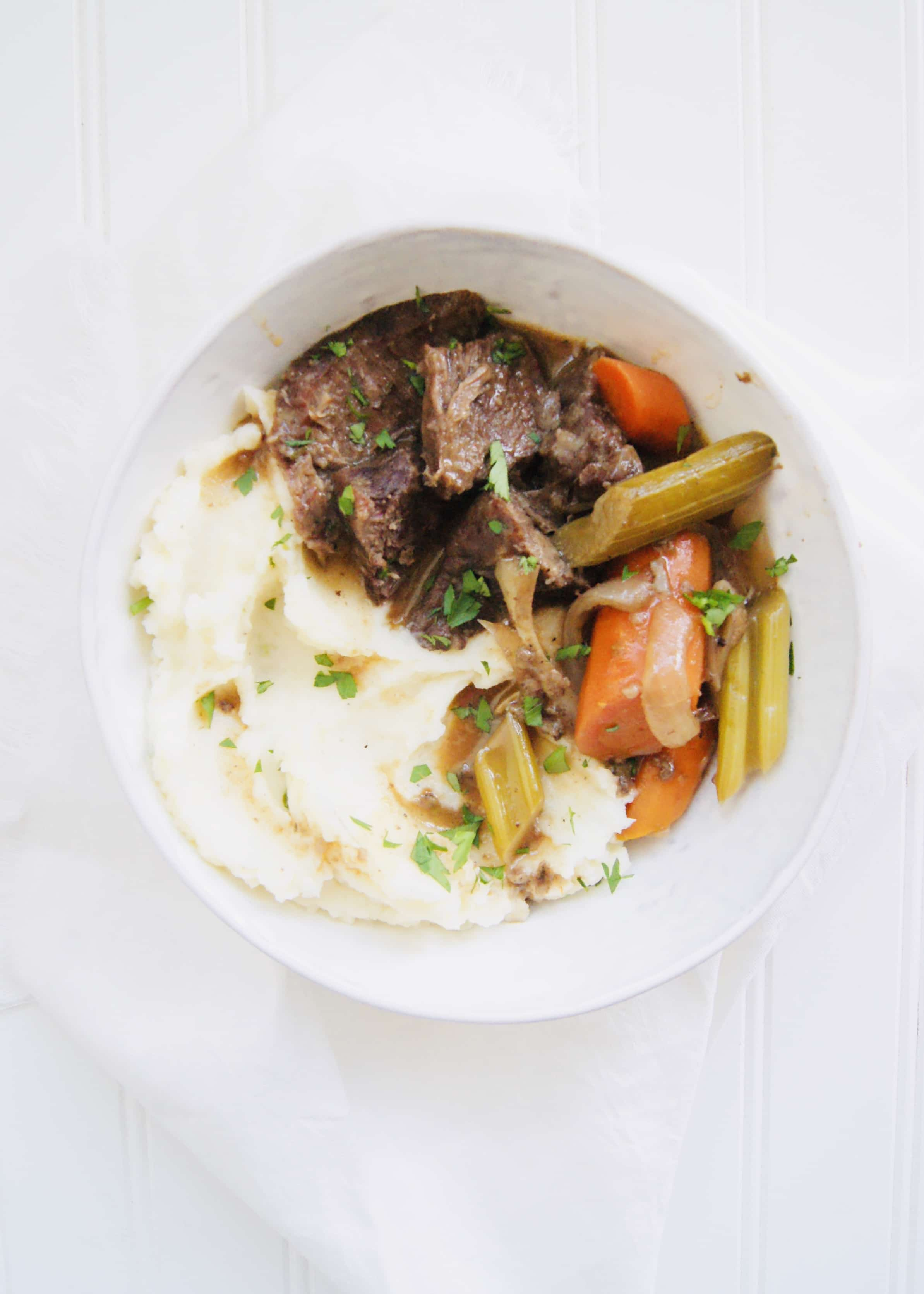The Best Slow Cooker Pot Roast with an easy, but delicious homemade gravy. Turn a chuck roast into a comforting, Sunday dinner. Recipe at KathleensCravings.com #kathleenscravings #slowcookerroast #potroast #chuckroast #sundaydinner #slowcookerdinner #slowcookermeal #slowcooker #slowcookersunday