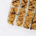 Pumpkin Energy Bars are like Pumpkin Granola Bars meets a cookie dough texture. Clean ingredients and no-bake! Store in the freezer for a healthy, sweet snack. Recipe at KathleensCravings.com #energybars #energyballs #pumpkinrecipes #cleaneating #plantbasedsnacking #vegansweets #vegansnacks