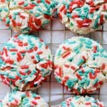 Easy Christmas Sugar Cookies are loaded with sprinkles, extra soft, and chewy. I love that there is no rolling or cutting involved. Just roll the cookie dough into balls and bake. Recipe at KathleensCravings.com #kathleenscravings #sugarcookies #dropsugarcookies #holidaycookies #christmascookies #baking #holidaybaking #easysugarcookies #sprinkles
