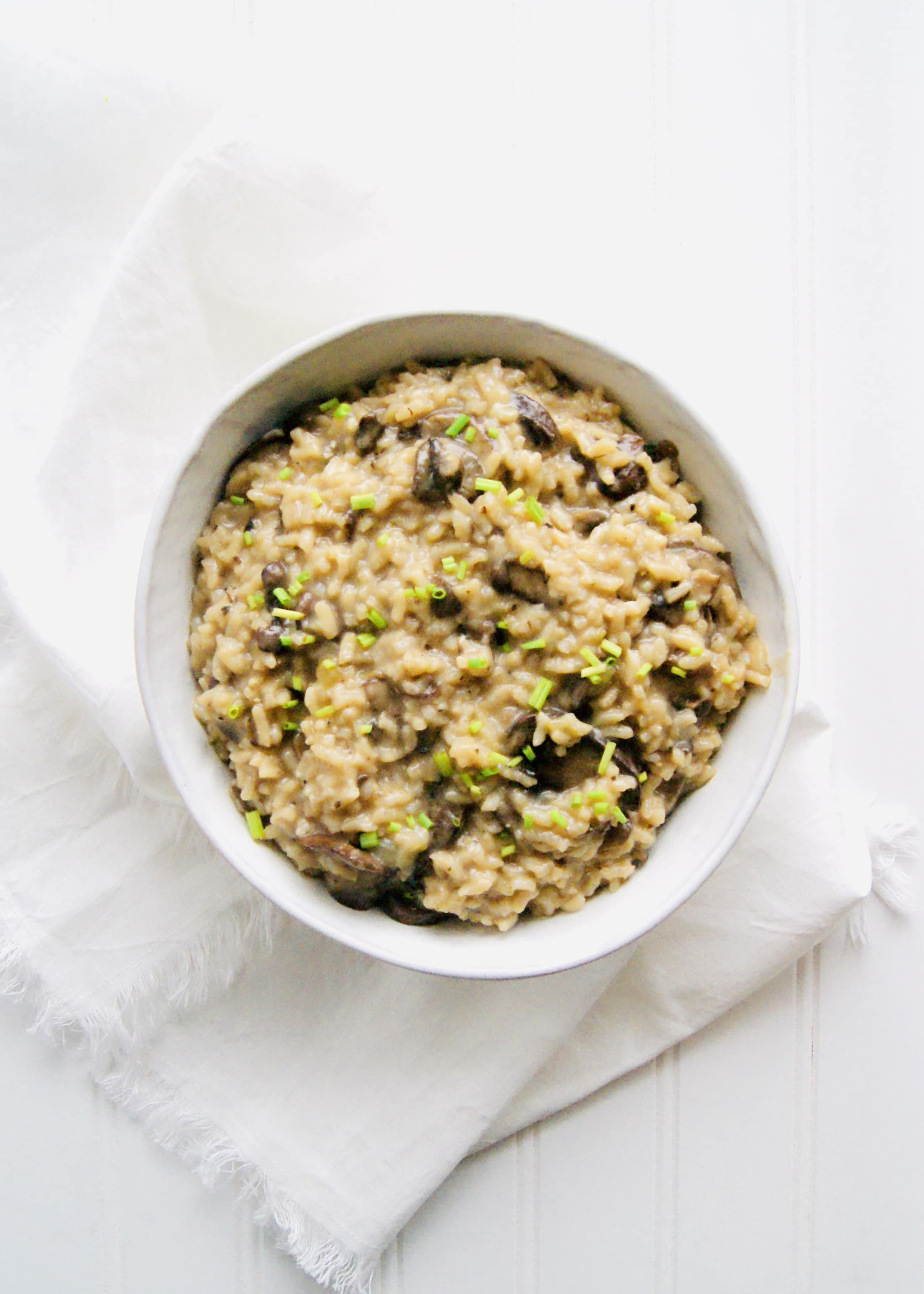 Instant Pot Mushroom Risotto is creamy and easy to make. Let the Instant Pot do all the work! Just a 7 minute cook time for this creamy mushroom risotto. Recipe at KathleensCravings.com #instantpot #risotto #instantpotrisotto #kathleenscravings #mushroomrisotto
