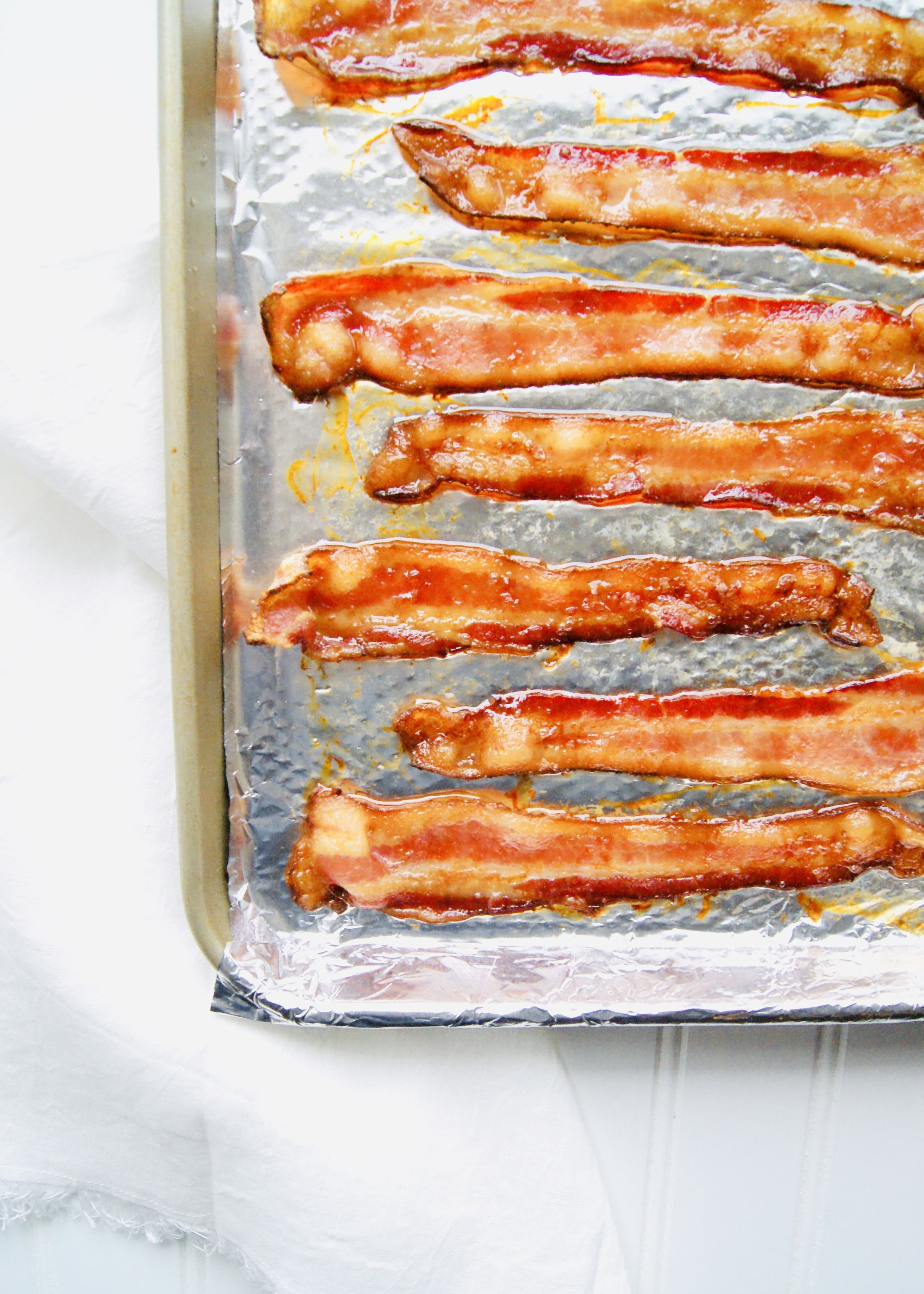 Oven Bacon is quick, easy, and no mess. Cooking bacon in the oven will be your new favorite technique! Recipe at KathleensCravings.com #ovenbacon #bakedbacon #breakfast #brunch #breakfastrecipes #baconrecipe