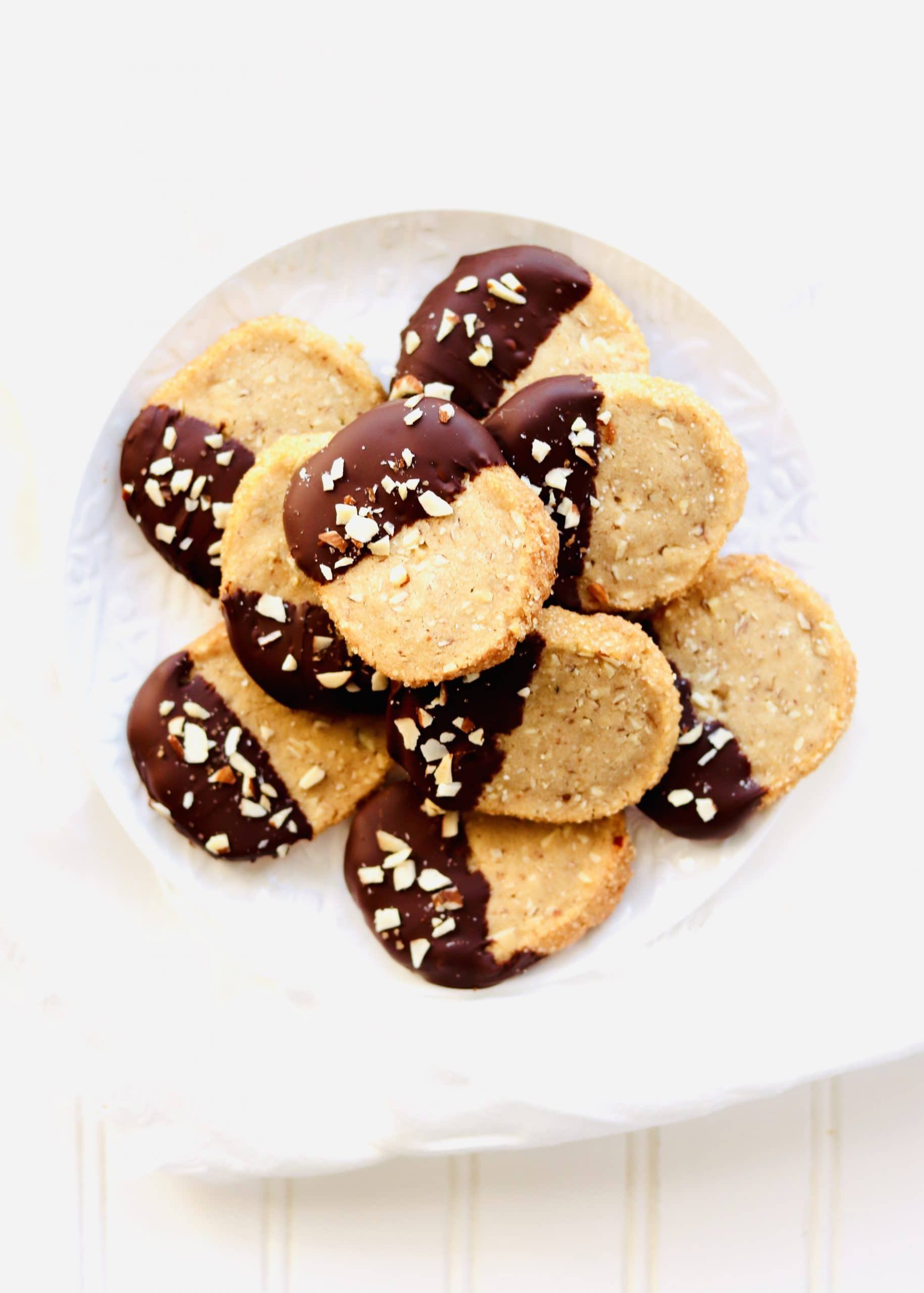Brown Butter Almond Shortbread Cookies are perfect to make for the holidays. Drizzling or dipping the shortbread cookies in melted chocolate takes them over the top! Just slice the cookie dough log into cookies and bake. Recipe at KathleensCravings.com #kathleenscravings #shortbreadcookies #cookies #brownbutter #christmascookies #holidaycookies