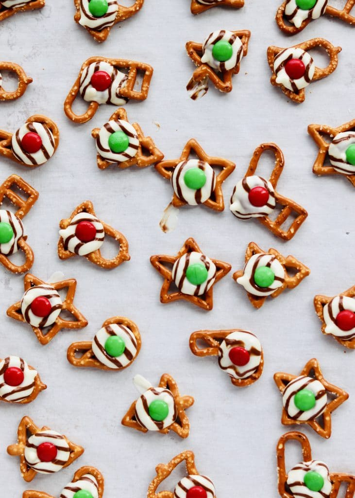 Christmas Pretzel Hugs are the perfect combination of salty and sweet. Easily made with just 3 ingredients and perfect to make ahead for some holiday prep. Recipe at KathleensCravings.com #kathleenscravings #pretzeltreats #pretzelhugs #christmascookies #holidaycookies #hersheyskisses