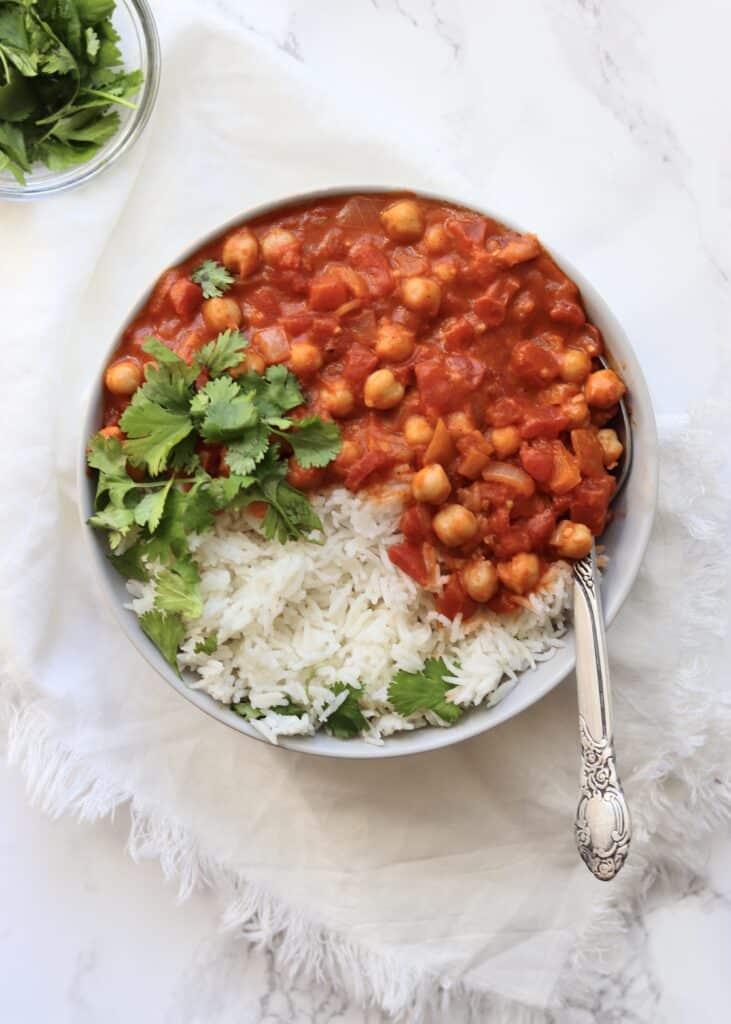 Chickpea tikka masala with white rice and cilantro