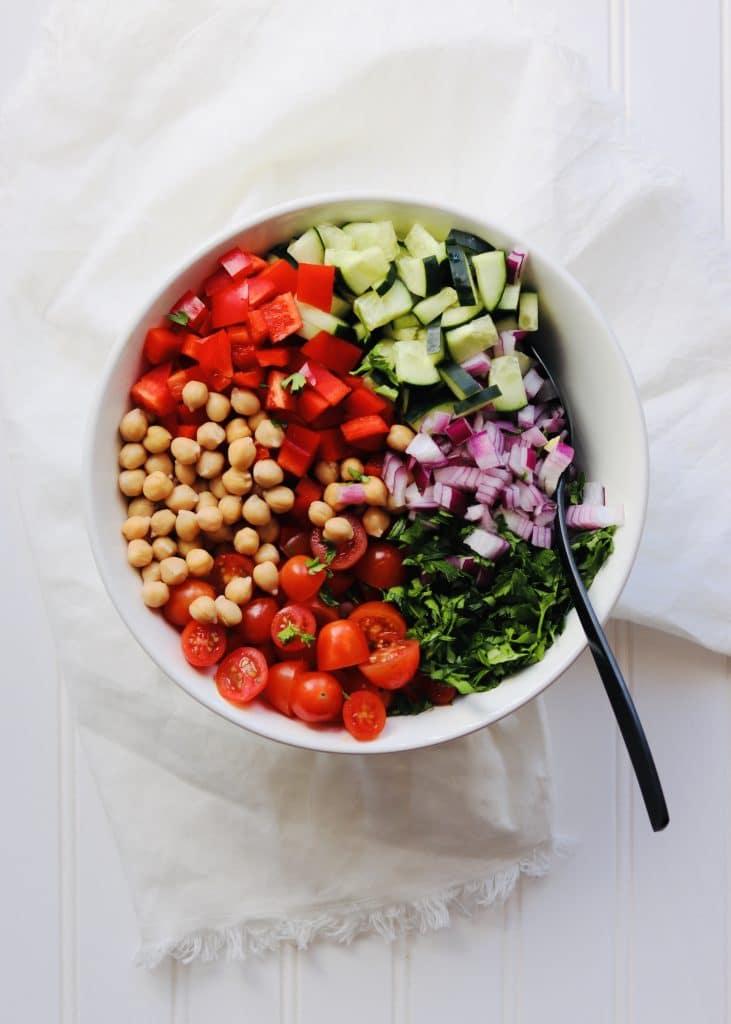 Greek Chickpea Salad ingredients with spoon