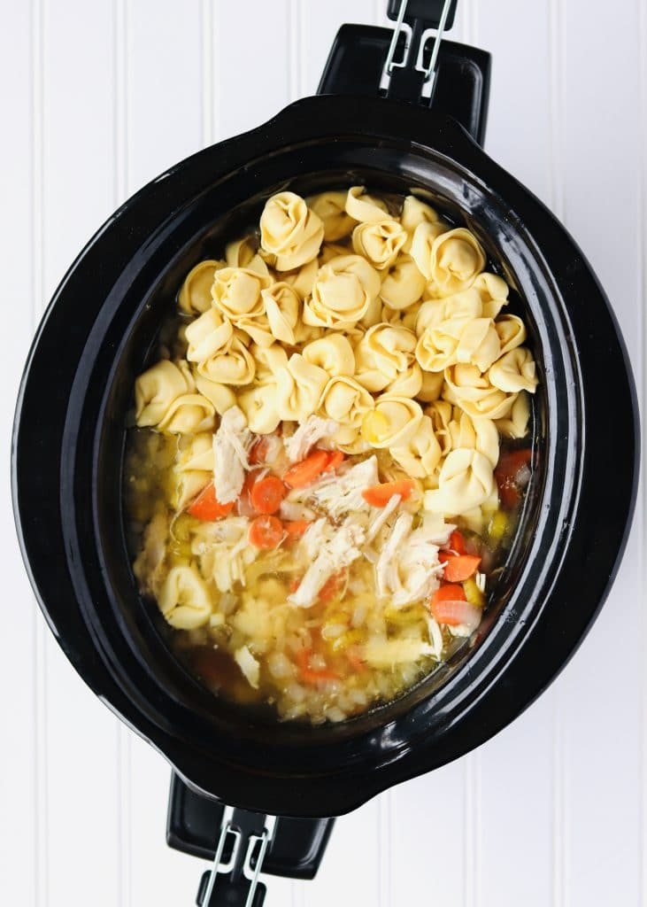Chicken soup with tortellini in slow cooker