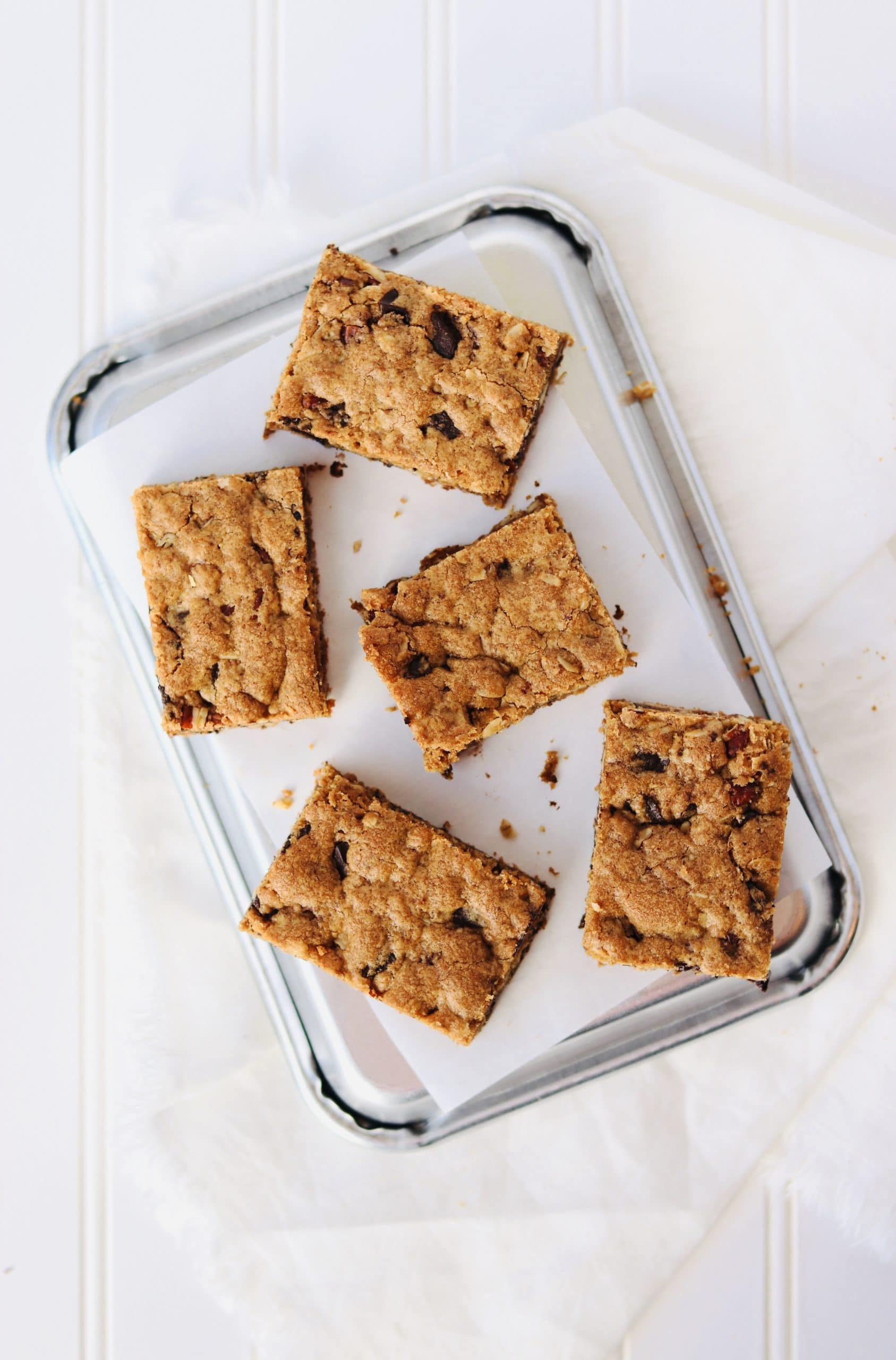 Brown Butter Pecan Blondies are the ultimate dessert. Rich and decadent flavor, crispy tops and edges, and chewy gooey centers. Browned Butter adds a nutty flavor and lots of mix-ins (oats, toasted pecans, and chocolate chunks) make these blondies anything but boring.