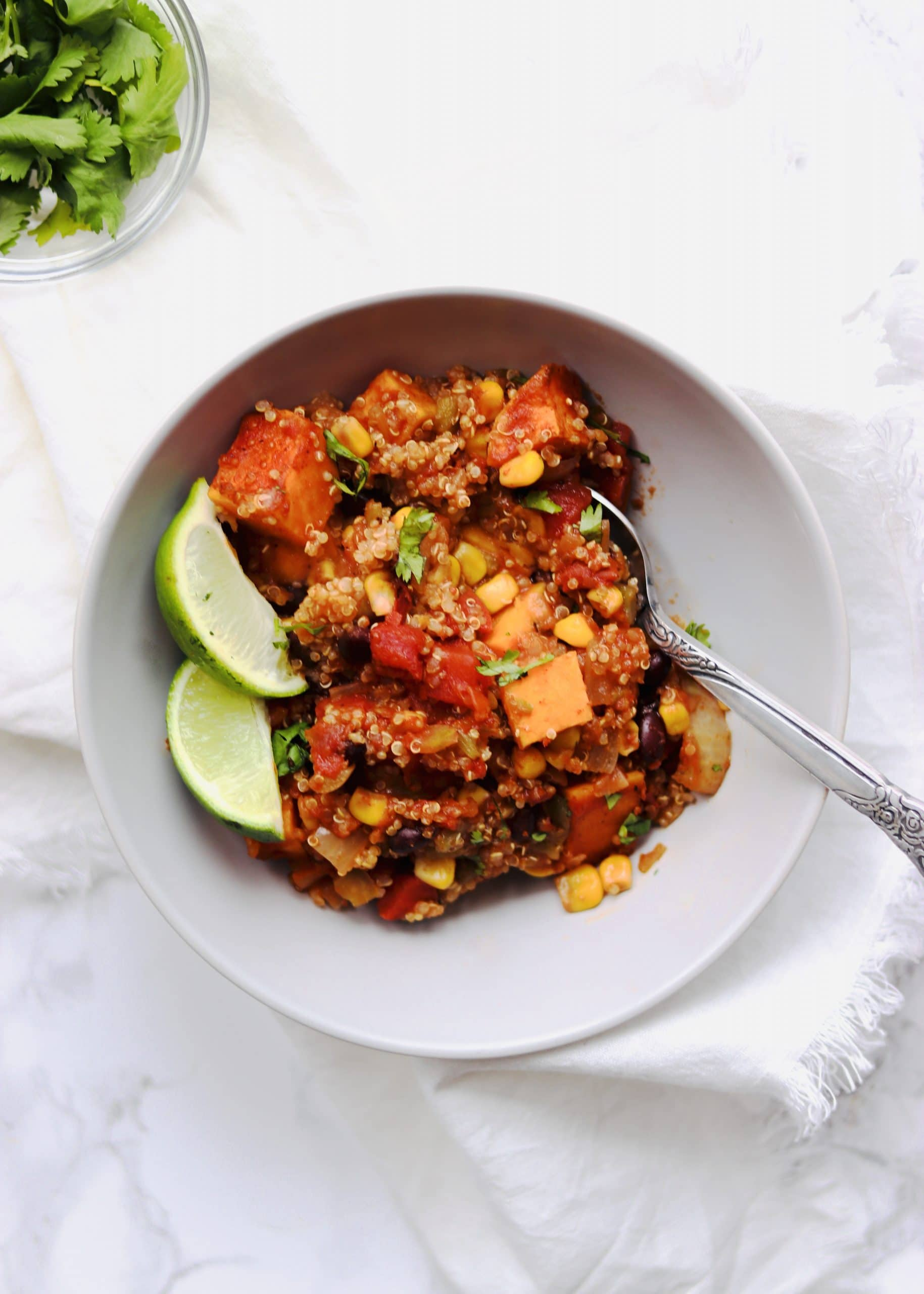 Vegan Mexican Quinoa Bake is healthy, filling, and uses all pantry staple ingredients! It takes just minutes of prep then into the oven to bake. This casserole is family friendly, perfect for Meatless Monday, or for a healthy meal prep.