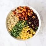 butternut squash, quinoa, black beans, corn, and cilantro in bowl