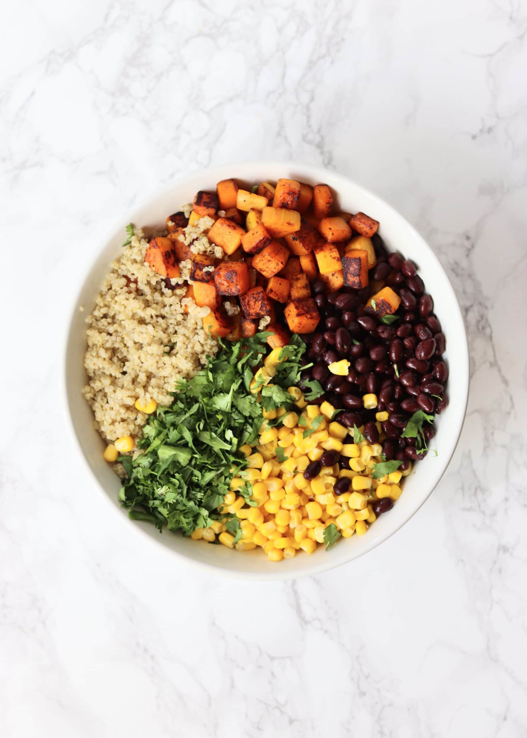 butternut squash, quinoa, black beans, corn, and cilantro in bowl