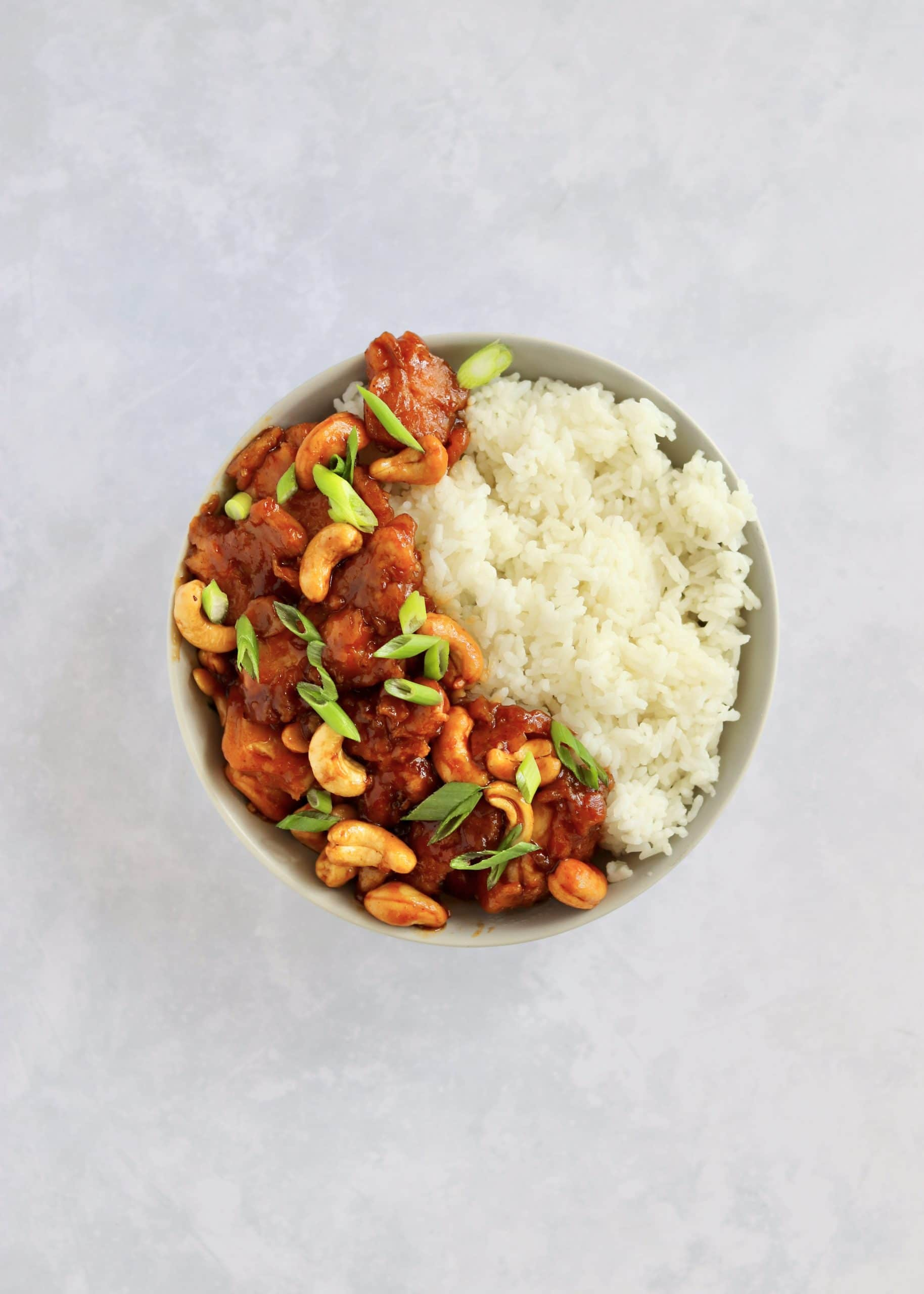 Cashew chicken with rice in a bowl