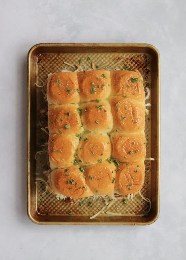 Unbaked chicken sliders on sheet pan