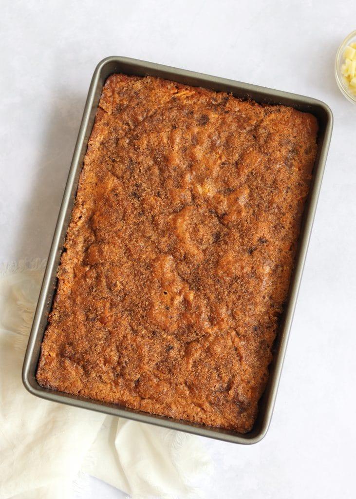 Baked Cinnamon Sugar Apple Cake in pan small bowl of apples