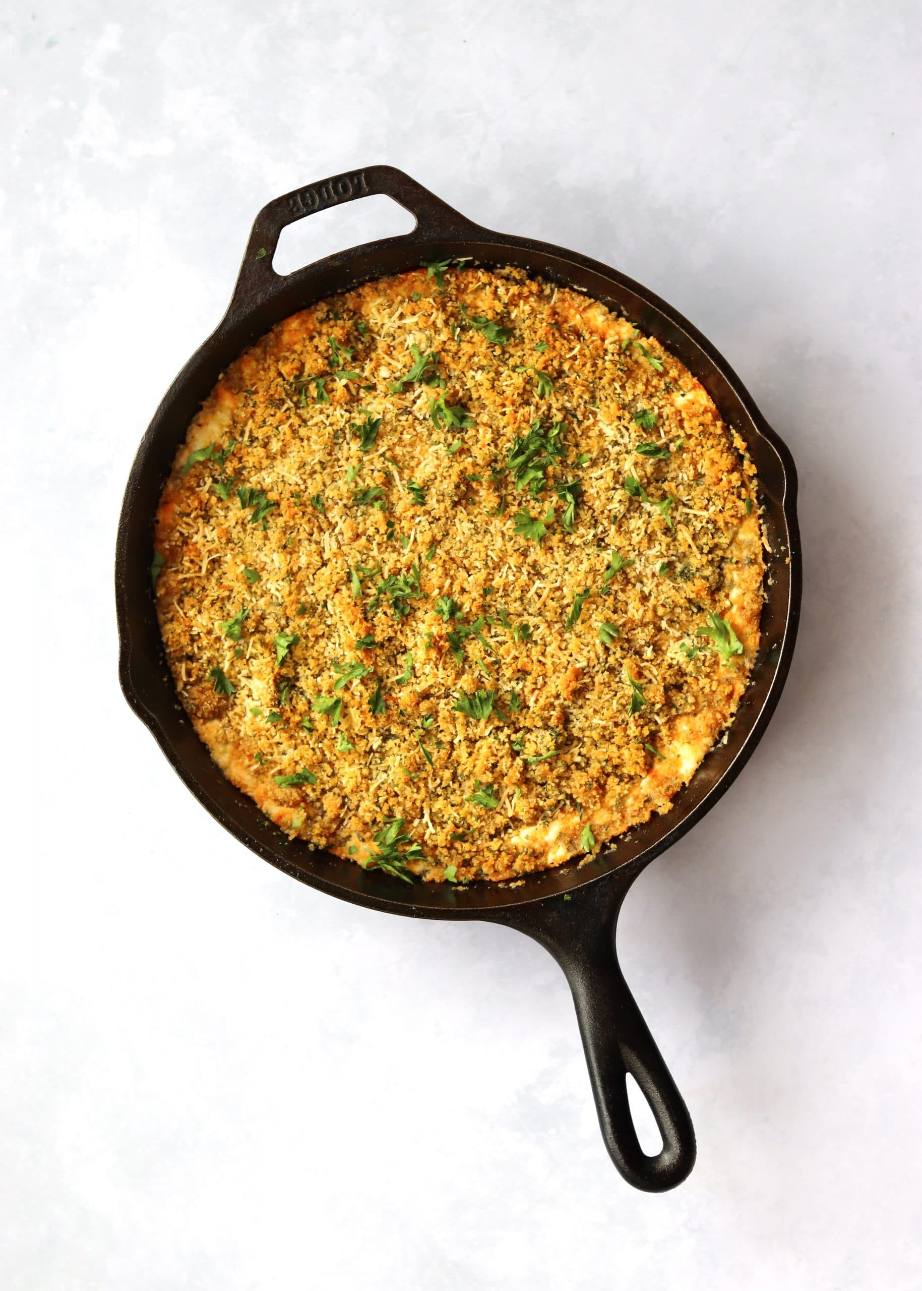 Jalapeno Popper Dip in cast iron skillet with parsley