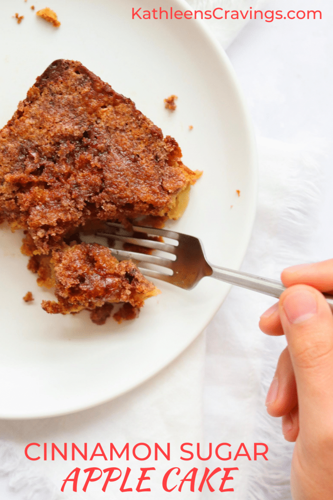 Piece of apple cake with hand holding fork and text overlay