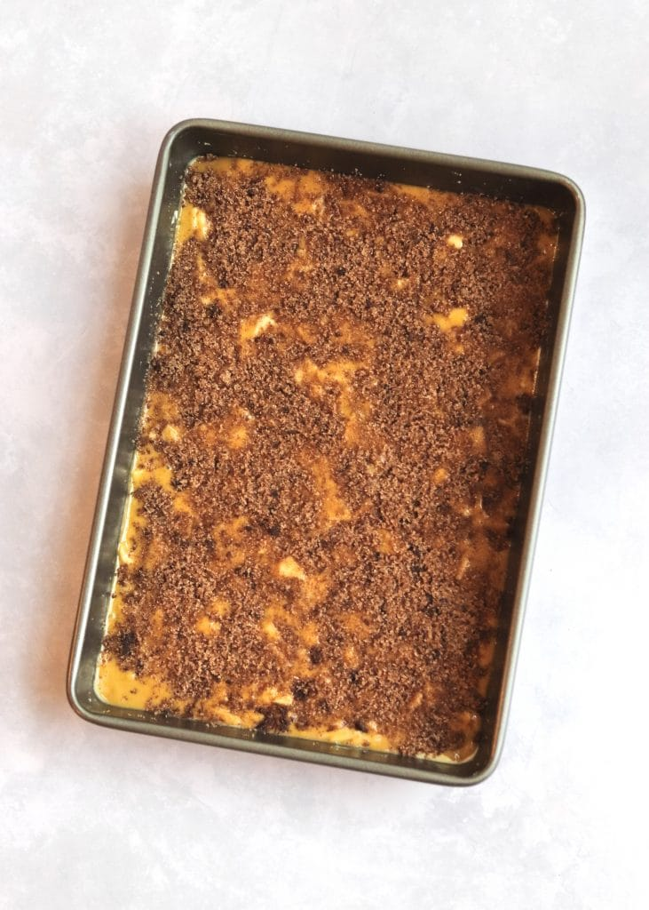 Cake batter in pan with cinnamon sugar topping