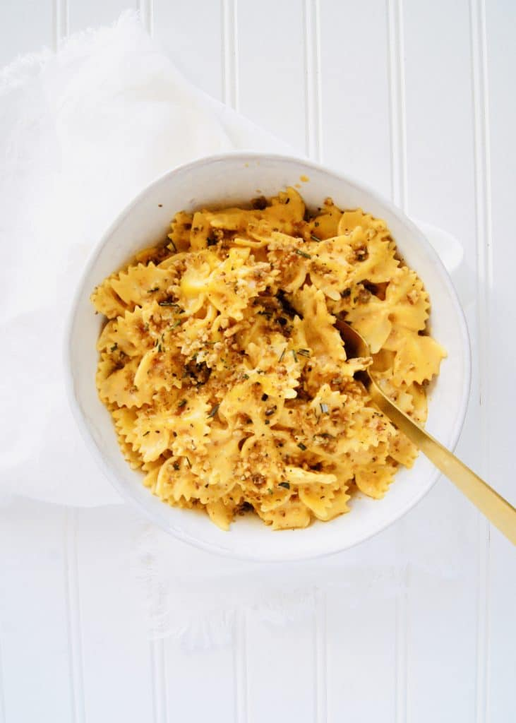 Bowl of Pumpkin Pasta with herbed walnuts on top