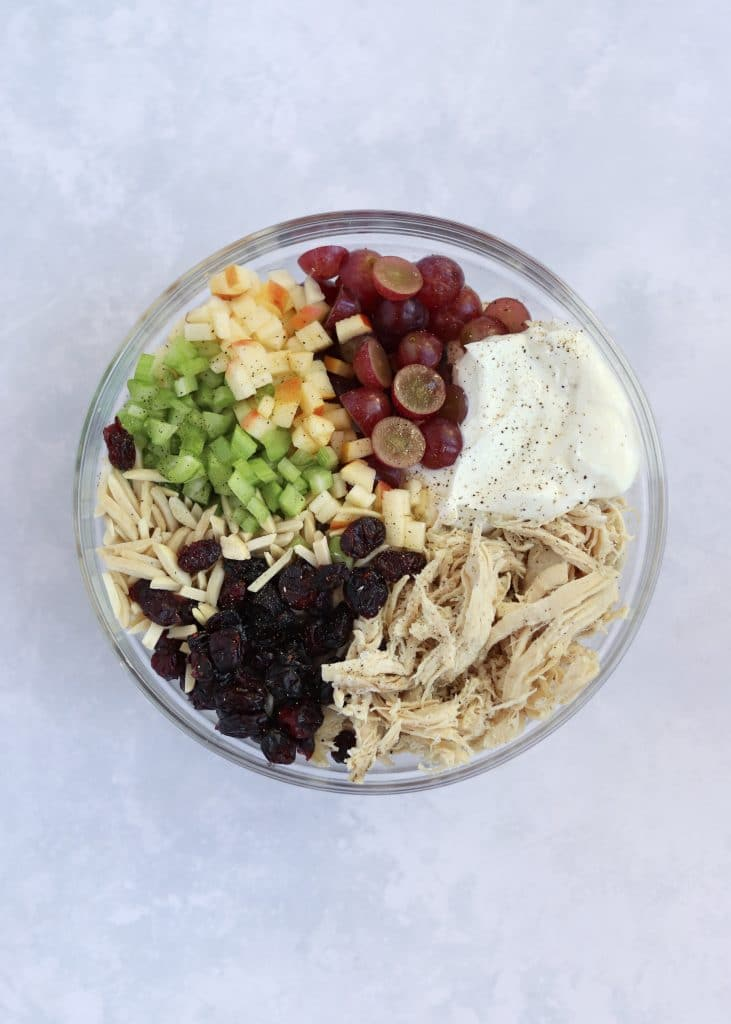 Chicken salad ingredients in glass bowl