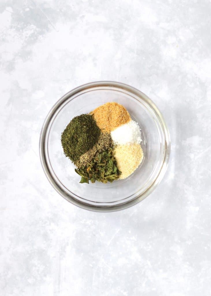 Garlic powder, onion powder, dried dill, dried parsley, salt, and pepper
