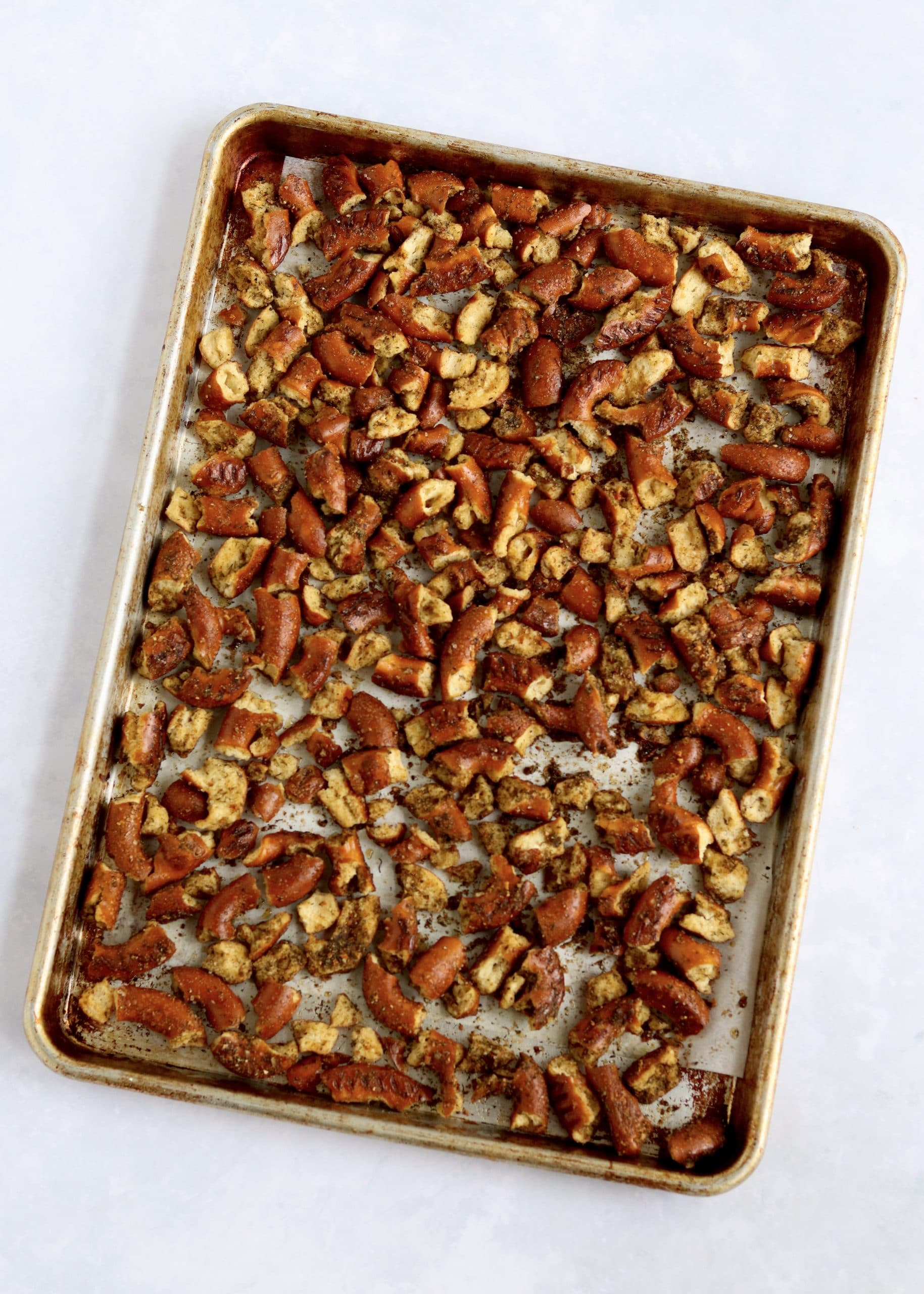 seasoned pretzels on sheet pan