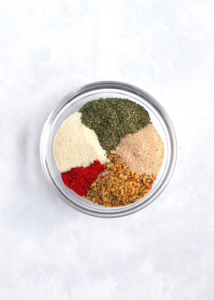onion powder, garlic powder, lemon pepper, dried dill, and cayenne pepper in a small bowl