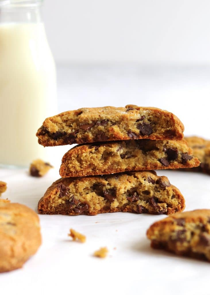 Stack of chocolate chip cookies with glass of milk