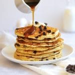 Maple Syrup being poured on chocolate chip pancakes