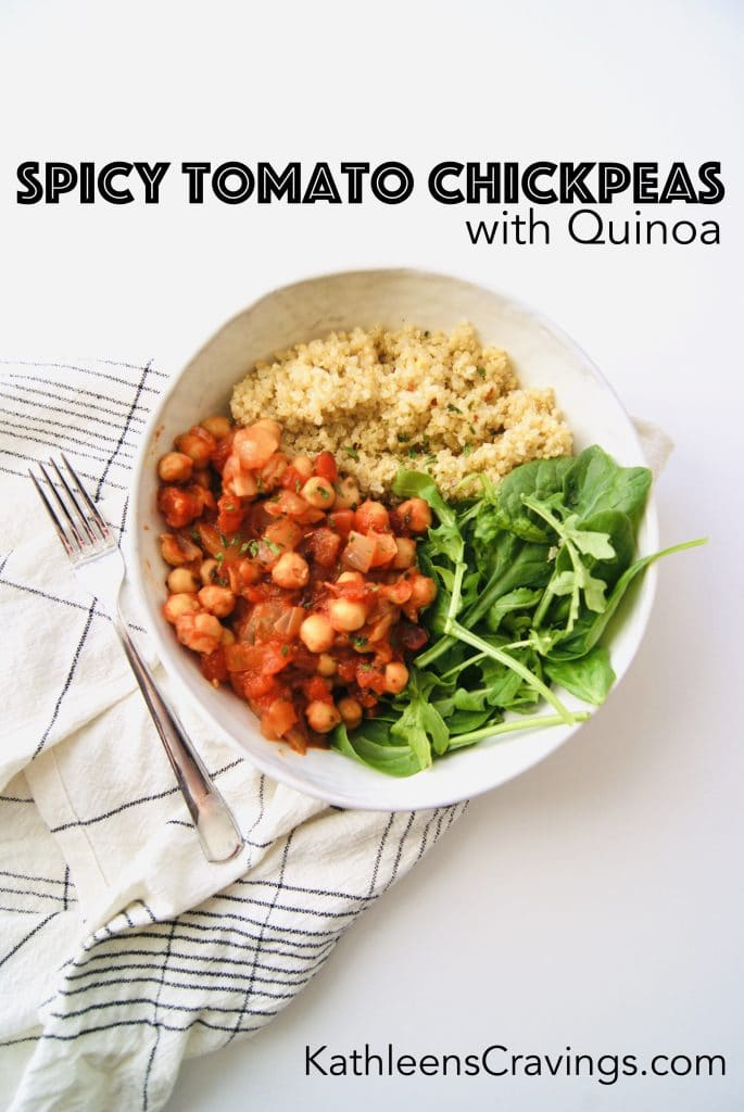 Bowl of spicy tomato chickpeas with quinoa and arugula