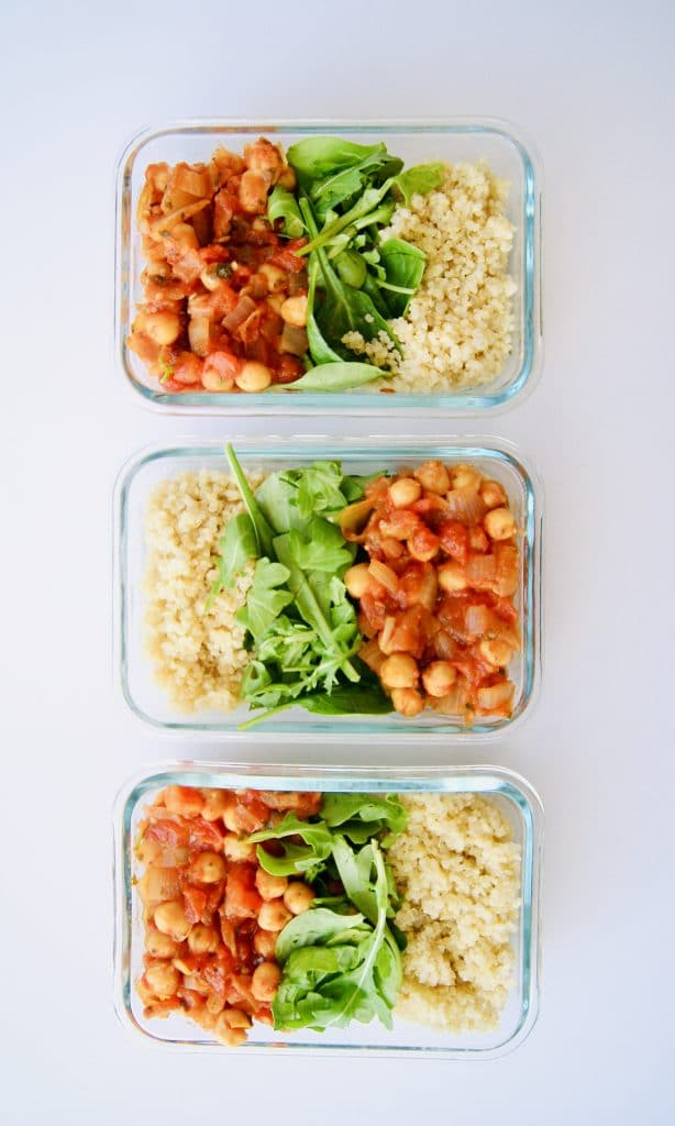 Meal prep containers with vegan tomato chickpeas and quinoa