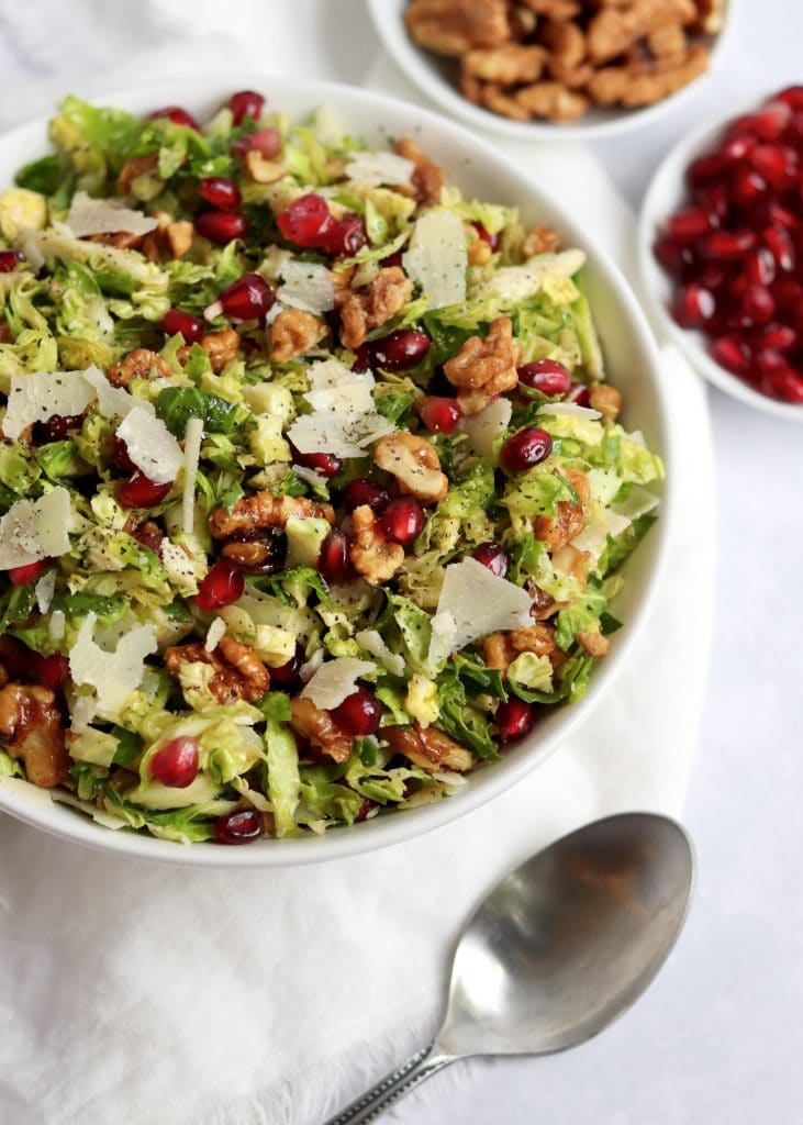 Shredded Brussels sprout Salad with pomegranate and walnuts