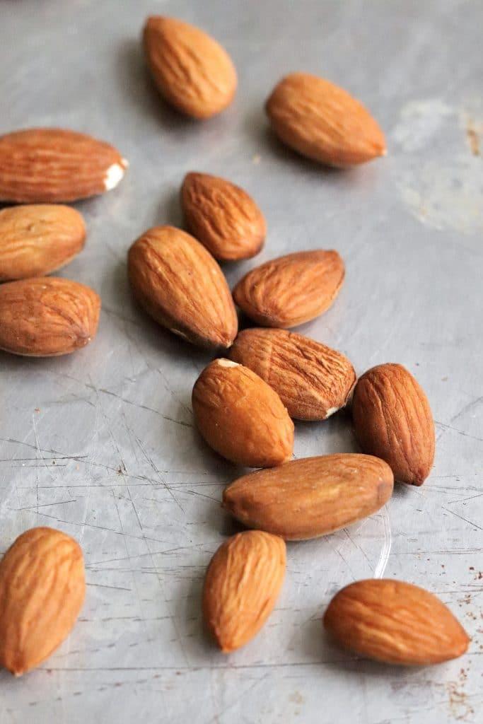 Toasted whole almonds on baking sheet
