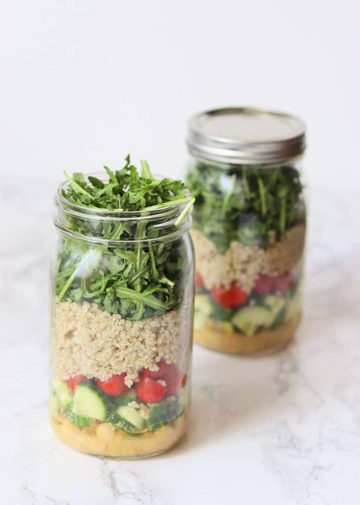 Two vegan mason jar salads with quinoa and chickpeas