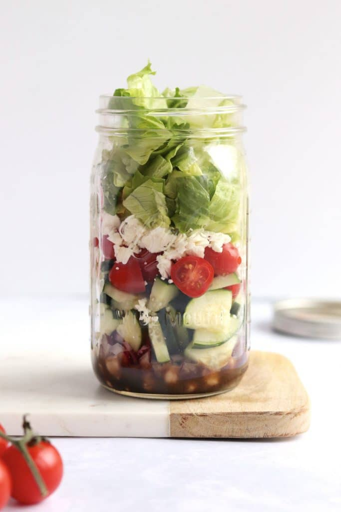 greek chickpea mason jar salad with extra tomatoes